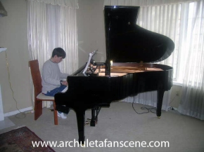 young-david-practises-piano-1